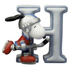 H IS SNOOPY PLAYING ICE HOCKEY! CANADA'S GAME, EH!