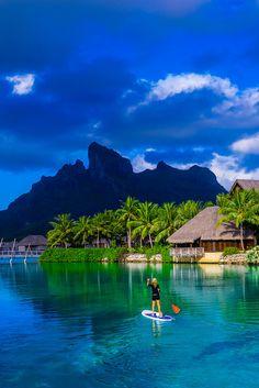 Standup paddleboarding in the lagoon, Four Seasons Resort Bora Bora, French Polynesia.