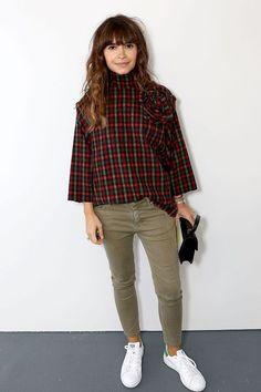 High neck plaid top worn with army trousers, and white trainers | Image via glamour.com