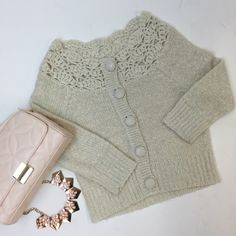cream buttoned sweater cute cream colored sweater with buttons. has silver metallic thread for a hint of sparkle! worn a few times, great condition! Sweaters