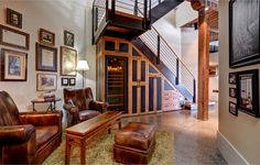 Wondering what to do with that space under the stairs...Incredible use of reclaimed wood in Portland Penthouse Condo