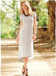 Ironwork inspired the jacquard damask patterning of this textural pima dress. Knit in cream on ecru, with a scoop neck, cap sleeves and a curvy A-line hem that dips longer in back.