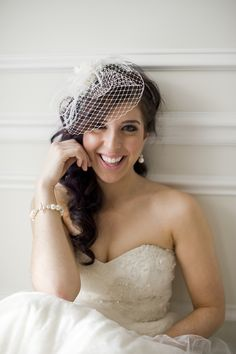 Bride hair & Birdcage Veil- Like having the hair down but swept to the side with the veil.