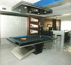Waterfall behind Stainless Steel Pool table designed by Nancyhugo.com