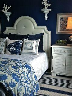white headboard/dark euro shams/ patterned comforter/ white coverlet