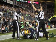 Report: NFL, NFLRA Reach Agreement; Refs Could Return For Week 4  -  Seahawks wide receiver Golden Tate makes a catch in the end zone to defeat the Green Bay Packers on a controversial call by the replacement officials. (Photo by Otto Greule Jr/Getty Images)