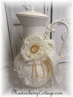 Lovely creamy ivory recycled glass coffee carafe! Painted heirloom white and accented with very vintage crochet, ivory beads, satin ribbons and a lace rose anchored with a pretty button.  For sale only, no instructions but inspirational.