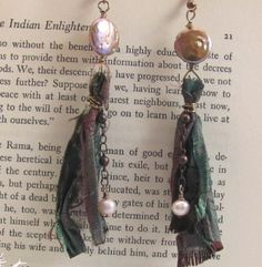The rich textured look of the Recycled Sari and Pearl Earrings provide a homemade touch that can only come with DIY earrings. If you're wondering how to make earrings that use fabric without looking clunky, this tutorial is a great example. Ribbon Bracelets, Ribbon Jewelry, Fabric Jewelry, Jewelry Crafts, Jewelry Ideas, Fabric Beads, Diy Jewellery, Jewelery, Handmade Jewelry