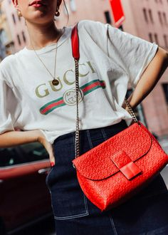 Carmen Hamilton (CHRONICLES OF HER) wears Gucci logo t-shirt, 3 x 1 denim skirt and red Loewe bag. SHOP HER LOOK HERE. Street style and fashion inspiration.