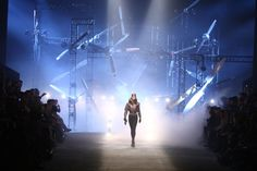 For Hermès's fall 2009 collection, Jean Paul Gaultier paid homage to female pilots, sending his chic versions of fly girls down the runway in luxe fur-collared bombers, leather leggings, and jumpsuits. Looming behind them as they emerged onstage through fog to the sounds of Casablanca and other classic films from the 1940s: dark scaffolding rigged with plane propellers and big lights, which, when you squinted, gave the impression of aircrafts flying toward the crowd.