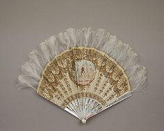 Late 19th century Tiffany & Co. Fan: Silk, Mother-of-Pearl, Metal, and Feathers, via The Metropolitan Museum Of Art.