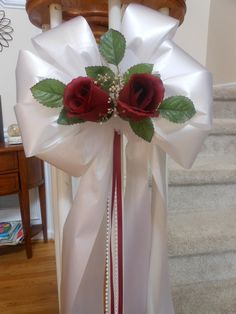 6 white, purple or pink pew bows wedding decoration with pearl stands chose color tulle, roses and accent ribbon. $27.99, via Etsy.