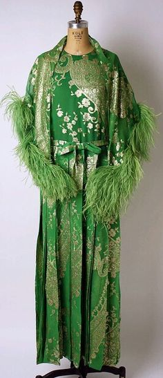 Evening ensemble (a–c) House of Dior (French, founded 1947)  Designer: (a–c) Marc Bohan (French, born 1926)  Date: fall/winter 1973–74  Culture: French  Medium: a,b) silk, metallic thread c) feathers d,e) leather  Dimensions: Length at CB (a): 59 1/2 in. (151.1 cm) Length (d, e): 10 in. (25.4 cm)  Credit Line: Gift of Mrs. Gerald van der Kamp, 1978