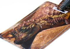 baby crocodile luggage tag recycled paper by HullStreetGreen, $8.00    This handmade luggage tag is created from recycled magazines/books/maps, is plastic coated and sewn with a sewing machine.  This means each luggage tag is one of a kind as we use the actual page and not a copy. It has a pocket sewn on with the opening facing the strap end of the luggage tag so that your information will not fall out. The plastic on both sides is water resistant and is easily wiped clean with a gentle…