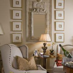 Love the wall arrangements, the nailhead wingchairs  www.yournestdesign.blogspot.com