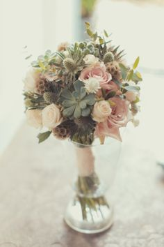 A simple and elegant wedding bouquet in soft pink and using succulents. http://jamesgreenphotographer.co.uk/