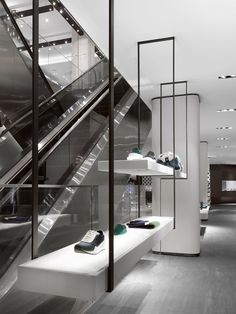 minimalist retail design with exposed form and cantilever structure