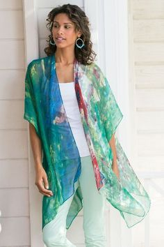 "A fine silk top layer in an impressionistic watercolor print defines summer with breezy chic. Whether you wear it over jeans or to the theatre, you'll make a creative statement that lives up to your unique style. Misses 32-1/2"" long. Silk Nile Topper #29262"