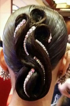 "I'm not sure how this ""ballroom hair"" works, but it looks almost like they take each individual strand and put it together..."