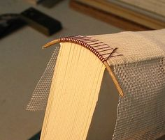 Sewing an endband onto a blank book. From my time at the North Bennet Street School's bookbinding program, 2002.