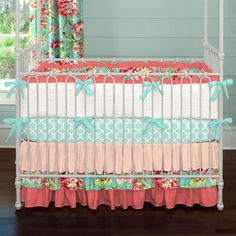 Coral and Teal Floral Three-piece Crib Bedding Set by Carousel Designs.