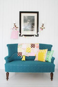 This blue settee would be perfect in a bay window in a bedroom.  It reeks of charm.