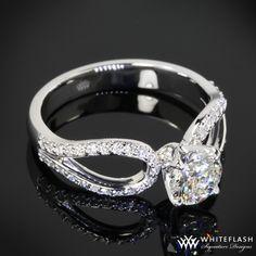 Diamond Engagement Rings...like the detail around the main diamond!