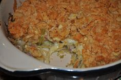 Can't Resist Cabbage Casserole  1 medium head cabbage, shredded  1 onion, diced  1 tsp. salt  ¾ C. butter, melted, divided  1/3 C. sour cream  1 (10.75 oz.) can cream of chicken soup  1 tube Ritz crackers, crushed  1 C. shredded cheddar cheese