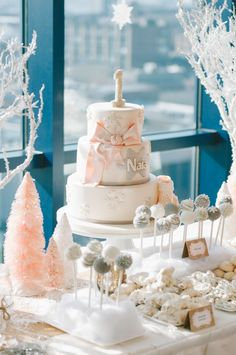 Photography: Ardita Kola Photography - arditakola.wordpress.com/ Cake: Sweet Panache Cakes - www.sweetpanache.com/ Read More on SMP: http://www.stylemepretty.com/living/2014/03/13/winter-wonderland-1st-birthday-party/