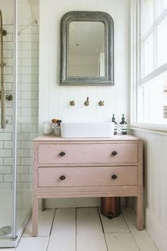 antique pink farmhouse vanity diy bathroom 16 Stylish Bathroom Vanities You Won't Believe You Can DIY Dresser Vanity Bathroom, Cheap Bathroom Vanities, Bathroom Vanity Cabinets, Cheap Bathrooms, Bathroom Pink, Country Bathrooms, Lowes Bathroom, Diy Bathroom Furniture, Master Bathroom