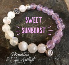 This popular half and half design is winning over many hearts.  This OOAK bracelet features a sweet little Hill Tribe Silver sunburst dangle.  Top quality Moonstone and top quality Cape Amethyst gemstones in this bracelet.  Did you know that Moonstone is the stone of new beginnings? Hill Tribe Silver | Cape Amethyst | Moonstone | Healing Jewelry | zenjewelz | ZenJen |NJ artisans | Wantage NJ
