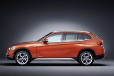 2013 BMW X1 in Valencia Orange, Xline. Not sure if this color will stay in style after a few years.