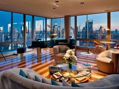 Fabulous living room with an amazing city skyline view [ Wainscotingamerica.com ] #family #wainscoting #design