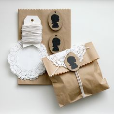 These would make such great wedding favours with cookies or tea inside... You could use a silhouette of the couple instead or what an awesome favour if you're having a tea party....brown paper, computer silhouettes printed out and cut out, paper doilies and white string--all at the dollar store...cheap, cheap but very unique. wedding decor; decorations; $store;
