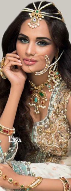 LAYA; Indian bride wearing decorated laung and head jewelry - a great South Asian bridal look. #ShaadiShop, #IndianWedding, #SouthAsianWedding