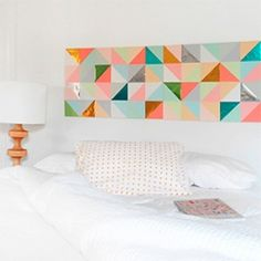 Tutorial to make this gorgeous geometric paper patchwork wall art.
