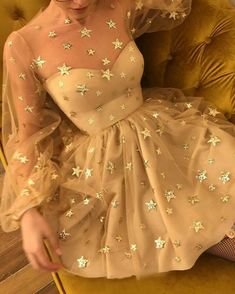 A star-crossed dress for a star-crossed lover.