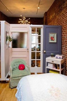 love this divider wall made of antique doors