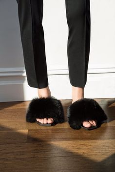 TheyAllHateUs....I'm not sure how I feel about this whole fuzzy/puff ball trend on shoes.....These slippers are ok. What does everyone think? #sandals #trend #fuzzy