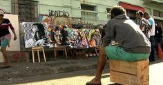 Dependentes químicos pintam painel com Eduardo Kobra na Cracolândia