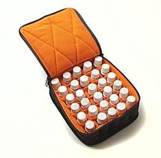 "A much better option than the plastic tote I was using!  30-Bottle Essential Oil Carrying Cases hold 5ml, 10ml and 15ml bottles - Black with Dusk Orange interior - 3"" high TheraPure Health Essentials http://www.amazon.com/dp/B002NHZ1ZW/ref=cm_sw_r_pi_dp_v1Fbub0547KQX"