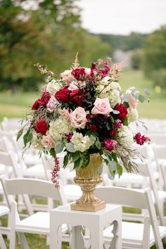 Gold Pedestal Ceremony Arrangement With Pink Roses and Red Ranunculus