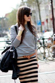 gray sweatshirt & stripe skirt.