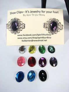 "Amethyst Shoe Clips Silver Filigree Purple Shoe Accessories Upcycled Shoe Clips! What a great fashion concept! A little bling for your feet can make a forgettable outfit memorable. What an economical way to add some personality to a plain pair of shoes. The dramatic shoe clips are made from antique silver tone filigree with a faceted acrylic cabochon setting. They measure 1 ½"" in across. The attached clip findings do not rub or irritate your skin. Shoes are not included in this sale. Youll…"