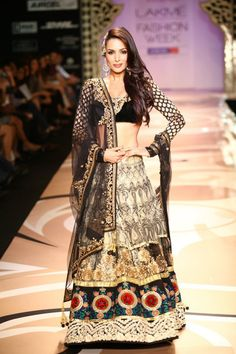 The black, cream, gold and red lehnga, along with the side-swept hair, is just stunning.