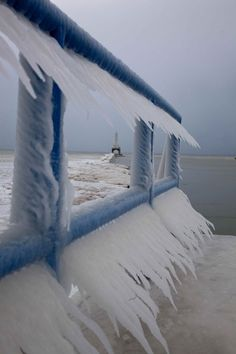 """""""Icicles form on a walkway along Lake Michigan in Port Washington, Wi., Tuesday, Feb. 1, 2011, in Milwaukee."""""""