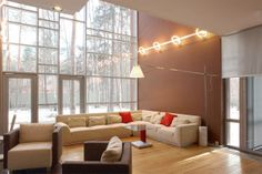 Impresive Russian House Designed by Andrew Stuben: impressive russian house living room interior designs with corner white sofas and windowe...