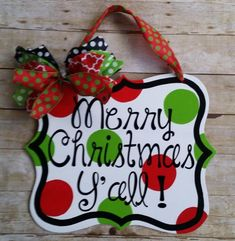 Merry Christmas yall wood door hanger, door decoration, is hand made out of sign material and is painted with red and lime green polka dots. Comes ready to hang with ribbon. Measurements are 16 x 18 . The words are made with outdoor sign vinyl. Christmas Wood Crafts, Christmas Signs Wood, Christmas Door Decorations, Christmas Yard, Burlap Christmas, Christmas Wreaths, Christmas Ornaments, Merry Christmas, Christmas Door Hangers
