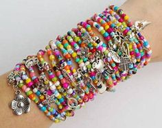 This are my best seller product of all time :) people love to wear them all at once... some times only a few of them.. Looks great with jeans and perhaps with other bracelets or a watch ;)  Colorful seedbeed bracelets, you are buying 20 bracelets in this listing. Each stretch bracelet is 19cm (7.50 inches)  Handmade with love
