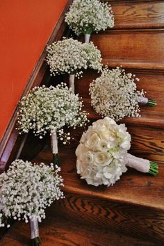 Gyp bouquets for bridesmaids, all roses for bride.